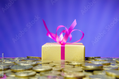 Euro coins and a gift box