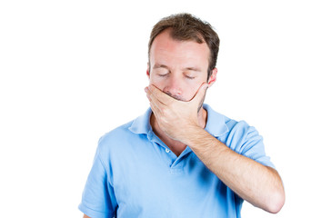 Man covering his closed mouth, speak no evil