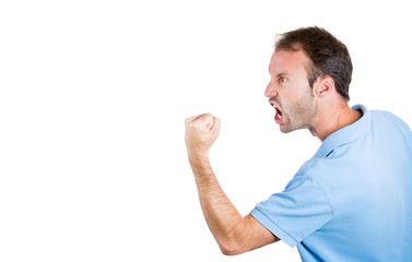Angry, mad, upset man with fist in the air