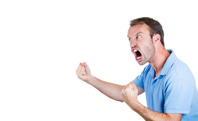 Angry, mad, upset man with fists in the air