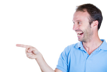 Portrait handsome excited man laughing  pointing finger