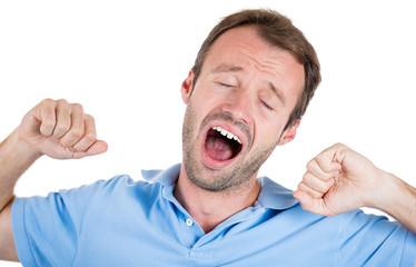 Sleepy, tired, fatigued man yawning