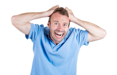 Stressed, overwhelmed, man screaming pulling his hair out