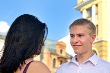 Attractive blonde man smiling at his girlfriend