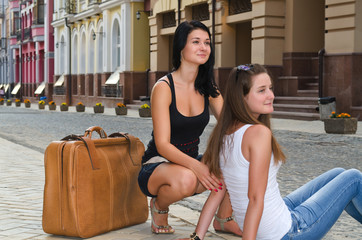 Two women on holiday waiting for a taxi
