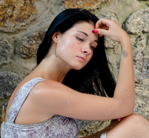 Sad beautiful young woman