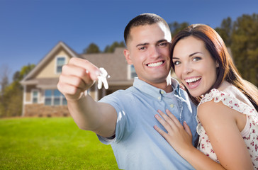 Military Couple with House Keys In Front of New Home