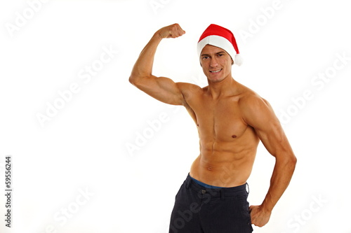 Atletic sexy Santa Claus shows biceps on white backgroung