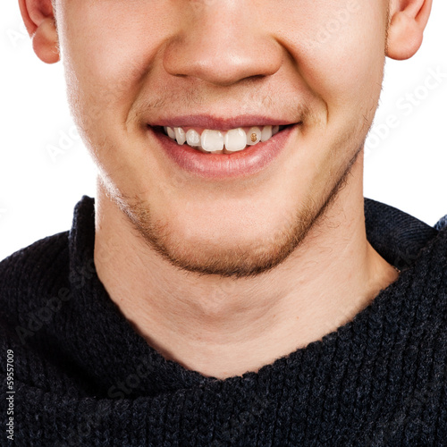 Detailed image of young man smiling