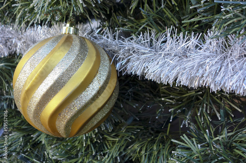 Golden Christmas Bauble on the Tree