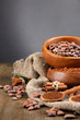 Cocoa powder and cocoa beans  on grey background