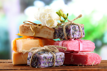 Natural handmade soap, on wooden table, on green background