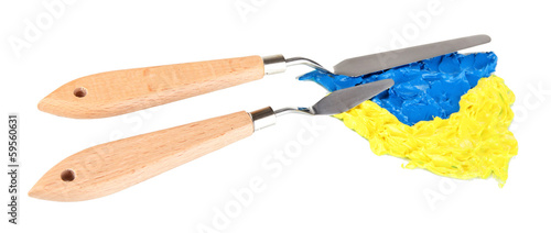 Painting palette knifes with paint isolated on white