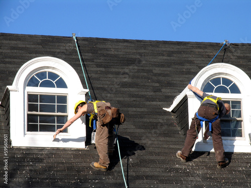 painters on roof of house