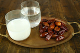 Conceptual photo of Ramadan food:dates palm, milk and water