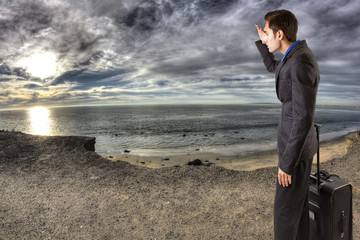 young businessman on HDR beach landscape