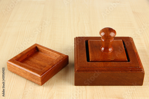 Wooden stamp on wooden background