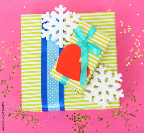 Colorful presents with luxury ribbons  on color  background