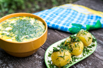 Russian national dish - Boiled potatoes and okroshka kvas