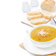 Cream soup of yellow lentils with vegetables, isolated