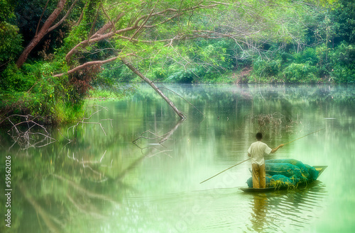 oarsman on nongchangkod River, Chiangrai, Thailand