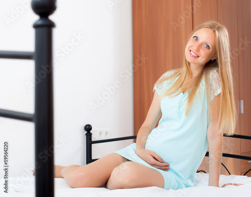 Cheerful long-haired pregnancy woman