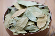 Close-up of a bowl full of dried bay leaves
