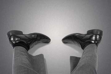 Fatigue and workaholism concept.Feet of the lying businessman.