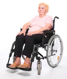 Elderly paraplegic woman sitting in a wheelchair on a white.