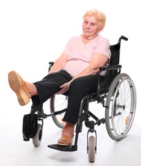 Elderly paraplegic woman exercising in a wheelchair on a white.