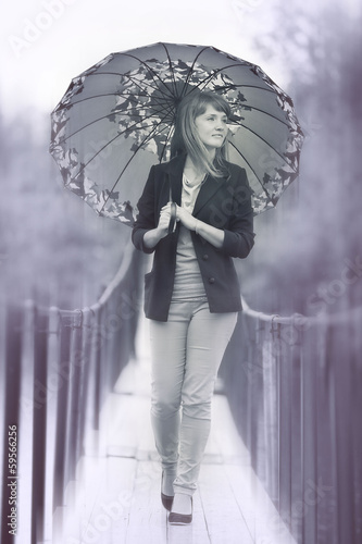 young woman under an umbrella in shades of gray
