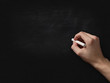 adult man hand to draw something on blackboard