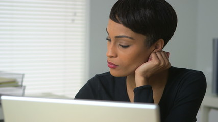 African American woman working in office