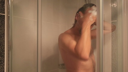 middle age brunette man taking a shower