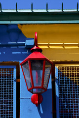 lamp  and a colorated  wall in la boca buenos aires