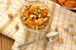 Oatmeal porridge with persimmons, pistachios and honey