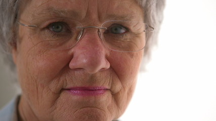 Closeup of senior woman looking at camera