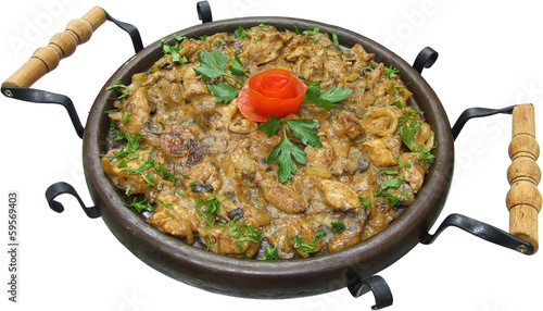 Traditional food with pork and chicken meat grilled on plate