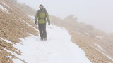 climber walking on snowy mountain