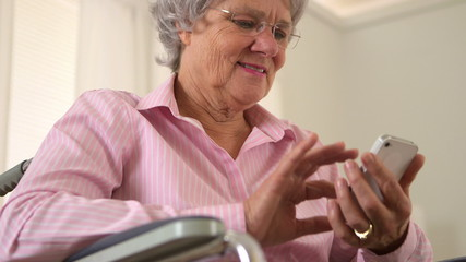 Happy grandma using smartphone
