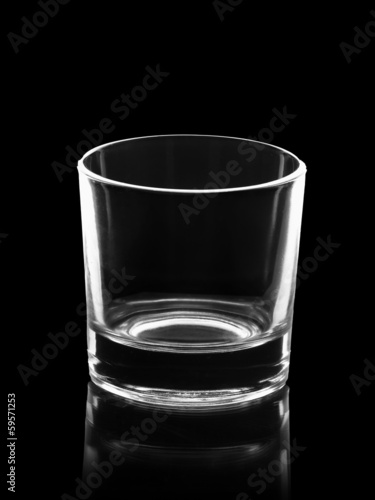 empty small shot glass isolated on black - 59571253