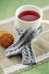 Cozy gray scarf on a tea mug