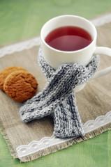 Cozy gray scarf on a tea mug