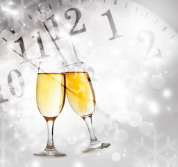 Champagne glasses and clock at midnight