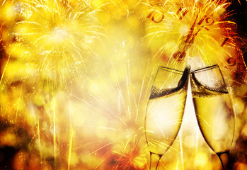 Champagne glasses and fireworks