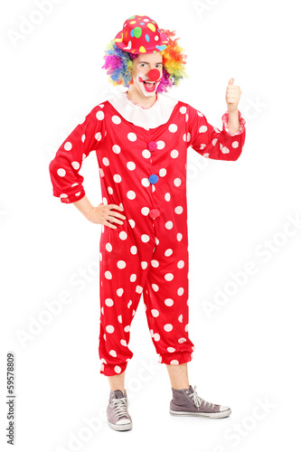 Full length portrait of a smiling happy clown in red costume