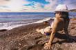happy smiling girl is sunbathing on a beach