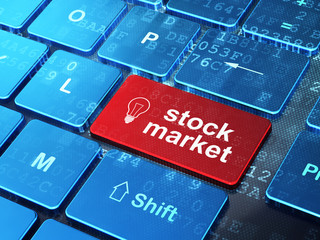 Finance concept: Light Bulb and Stock Market on computer