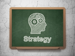 Business concept: Head With Gears and Strategy on chalkboard