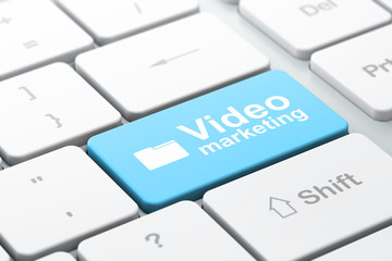 Finance concept: Folder and Video Marketing on computer keyboard